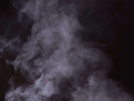 Photo of steam in front of a black background