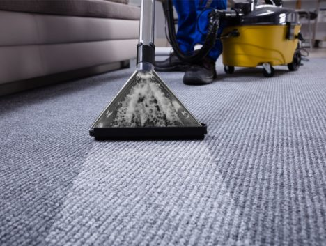 Carpet Cleaning Parramatta team member vacuuming an office carpet in Parramatta