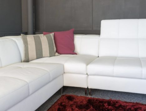 White upholstered couch that has been professionally cleaned